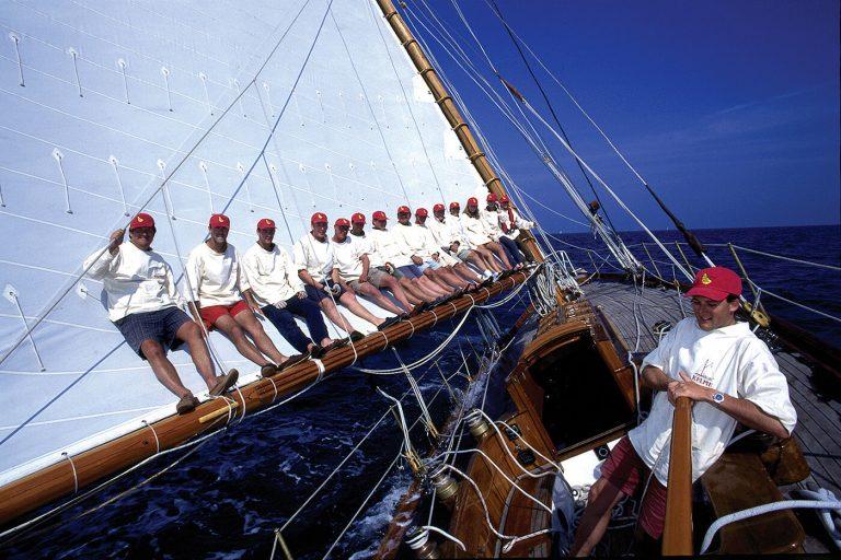 crew on the boom of classic yacht Kelpie