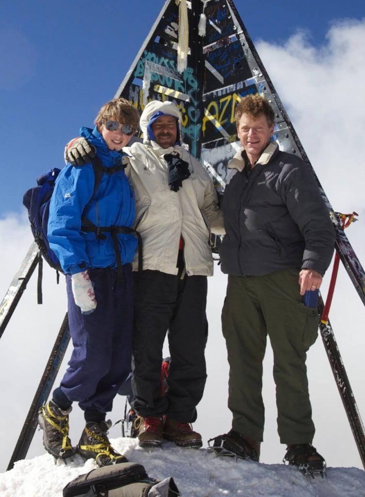 James Walker and son at the summit of Mount Toubkal